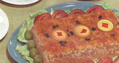 Corned Beef Salad Loaf (Knudsen Recipes, 1959).  I feel the three medallions at the top are trying to give me a message.