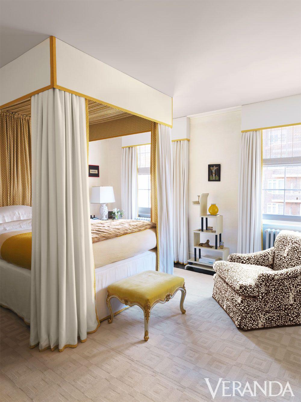 Custom canopy bed in Claremont fabrics; bedding, Volga Linen; custom armchair in a Tissus d'Hélène fabric; 18th-century English ottoman.    - Veranda.com