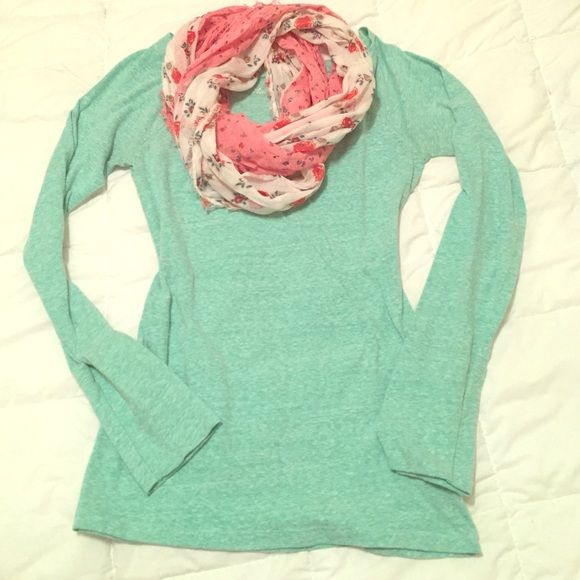 AEO Long Sleeved Tee This super cute top is a sea foam green and is a perfect canvas for your detailed scarves! 55% Cotton 45% Polyester. Ready to make its home in your closet!  American Eagle Outfitters Tops Tees - Long Sleeve
