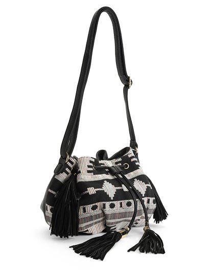 Multicolor embroidered fabric paired with black leather is the perfect duo in our Tassel Bag. You can really wear it with everything. We love the slide rope closure and adjustable shoulder strap.