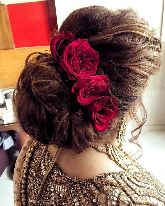 Indian Bridal Hairstyles Inspiration Messy Hair Buns Adorned With Red Roses Indian Brida Indian Wedding Hairstyles Bridal Hair Buns Bridal Hair Inspiration