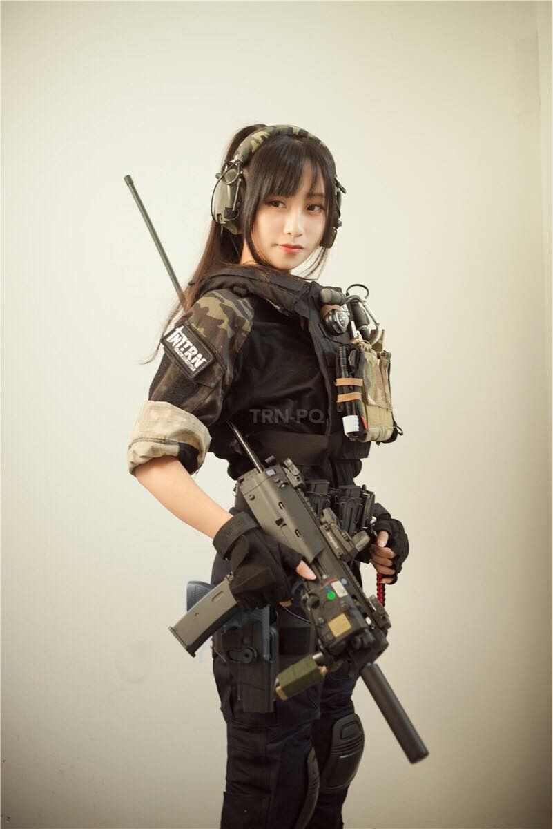 Rather Asian girl with ar 15