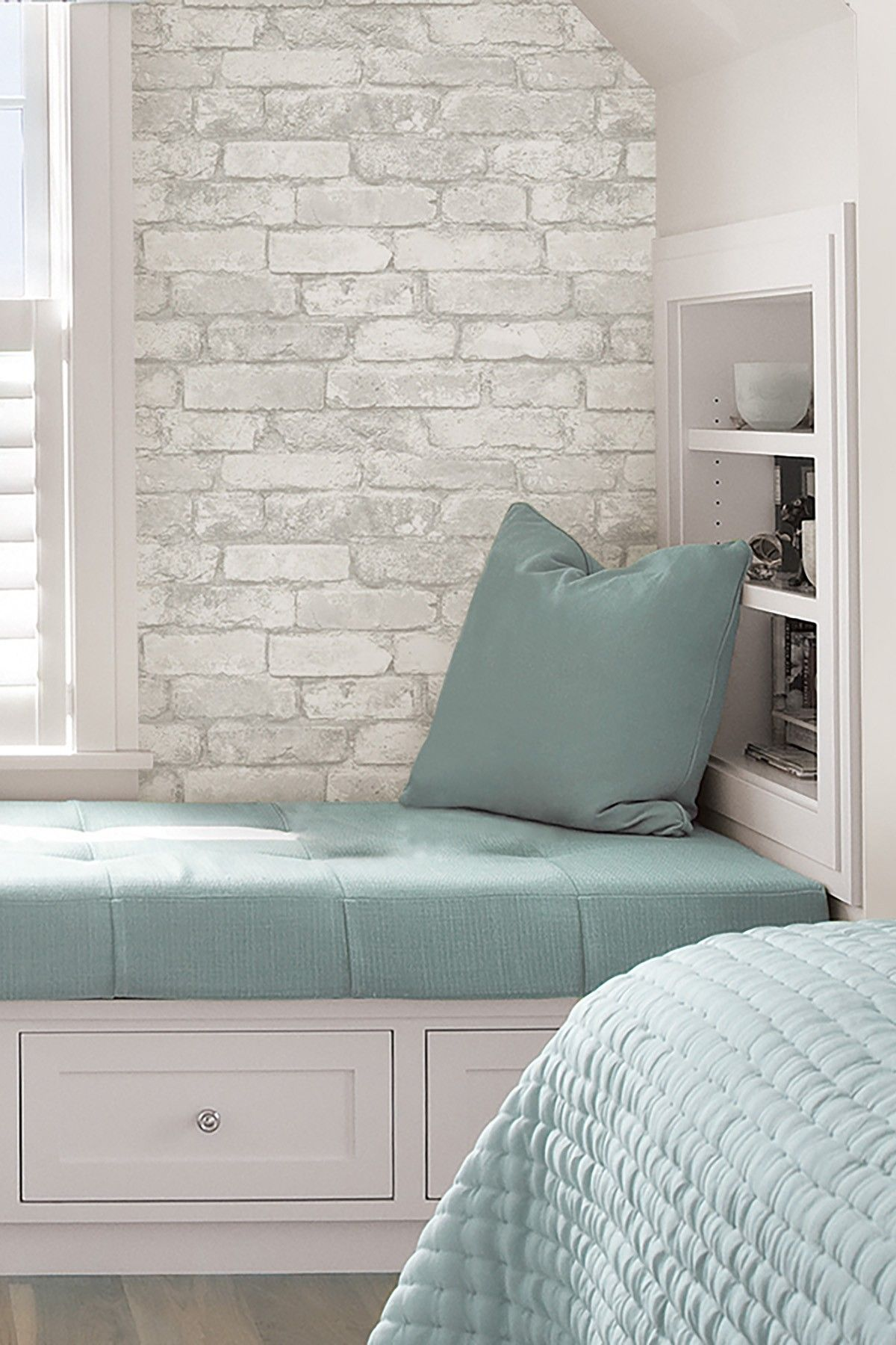 Create an elegant statement with a white brick wall for Grey wallpaper bedroom