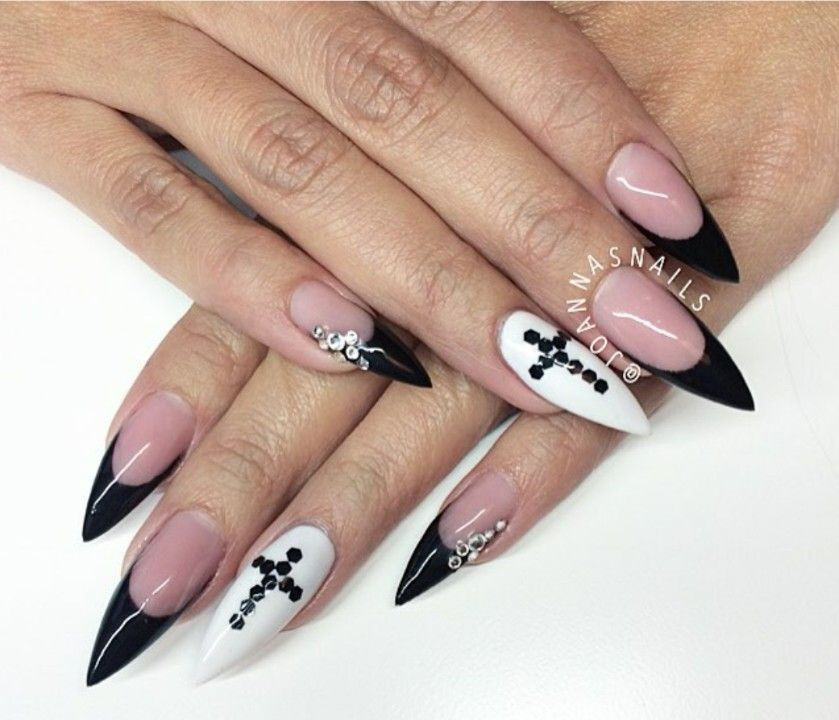 Black french stiletto nails with white accent nails with cross ...