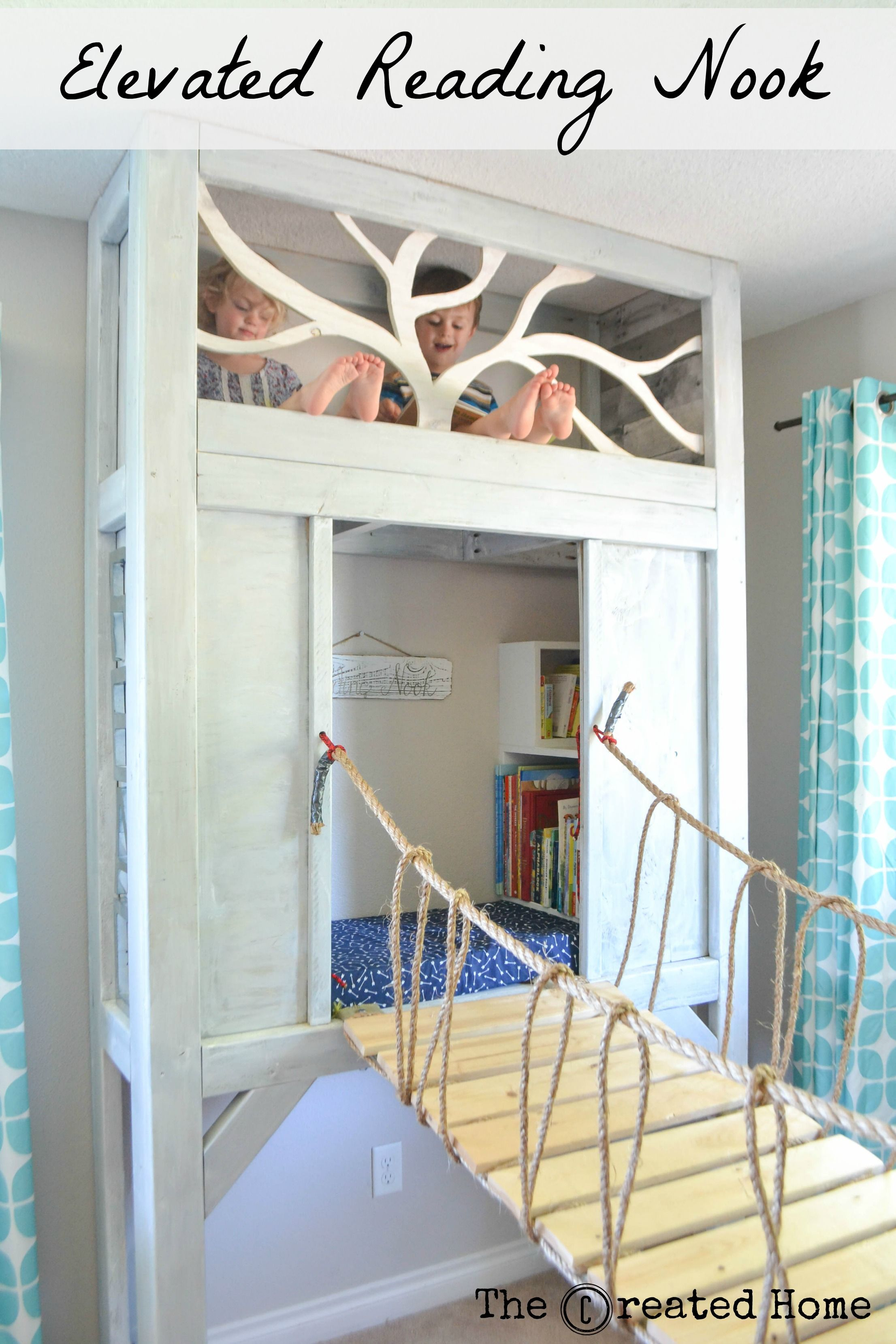 DIY elevated reading nook with bookcase steps to a kid sized loft