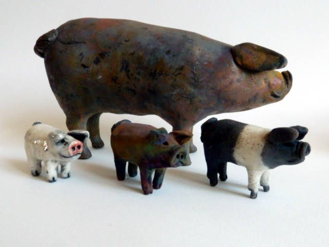 Raku sculpture - mummy pig with copper fume glaze and 3 micro pigs