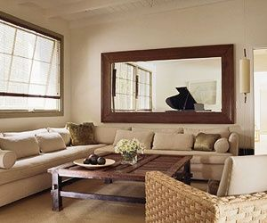 Horizontal mirror over couch echoes and reflects light for Long living room mirror