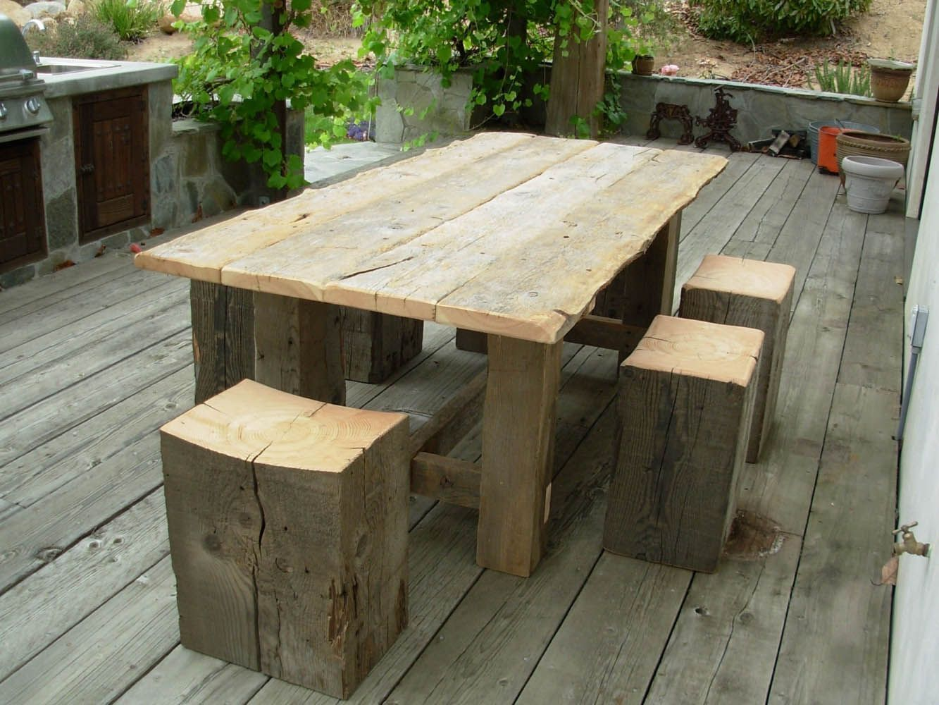 This outdoor patio table was built for the Vintage Timberworks Temecula showroom using weathered Gray Board planking with worn rustic edges. The table base was built with 6x6 Douglas fir timbers and the solid block stools were cut from 12x16 beams with a slight curve in the top for comfort. Products Used: Sanded Gray Board Plank, Sanded Douglas Fir Beams