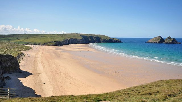 A view of a sandy beach on a sunny day