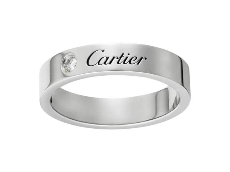 Cartier A Simple Platinum Engraved Wedding Band With Diamond Set Next To The