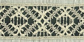Venetian Bobbin Lace  This 16th-17th century Italian insertion represents a bridge between the braid laces and those with all parts made simultaneously. The intriguing design consists essentially of two ornamented scrolling braids made simultaneously between two borders