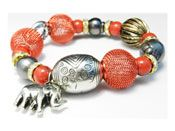 Elastic bracelet with silver fancy items and checkered red balls and three baroque Tahitian pearls 10 mm diameter