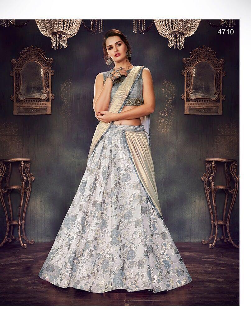 e98c1057f6 Mahotsav Elegant Designs With Heavy Embroidery Grey Colour Lehenga. Design  No-4710. Lehenga-Fance Brocade. Blouse-Dhupiyan Net Grey Colour.