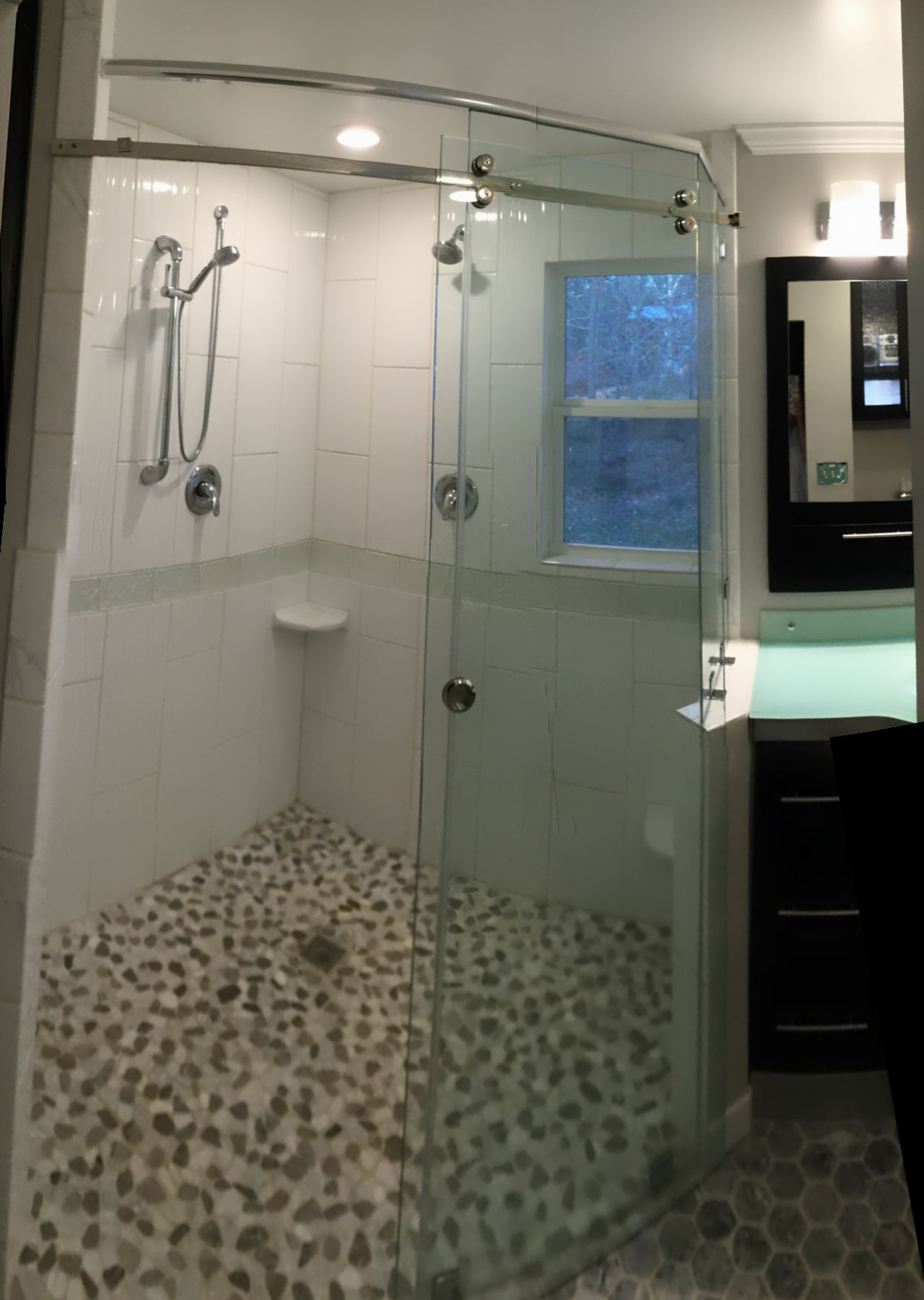 Small bath remodel created diagonal shower for huge effect