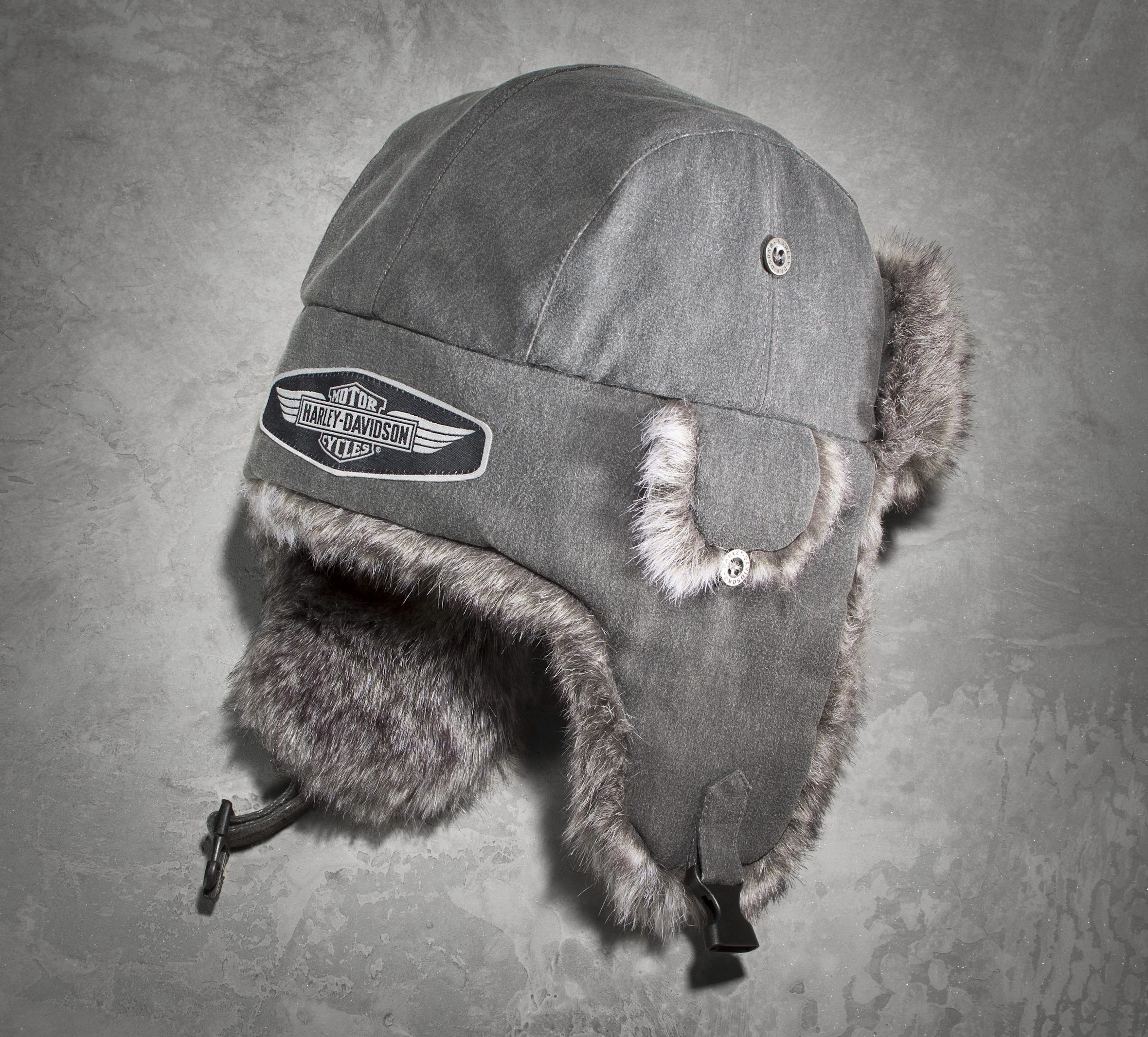 fc494fac32eaf Outsmart the never-ending winter weather in our faux fur lined winter cap  with ear flaps.