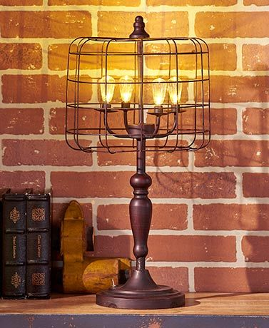 This industrial style decorative led lamp emits a warm illumination anywhere you place it