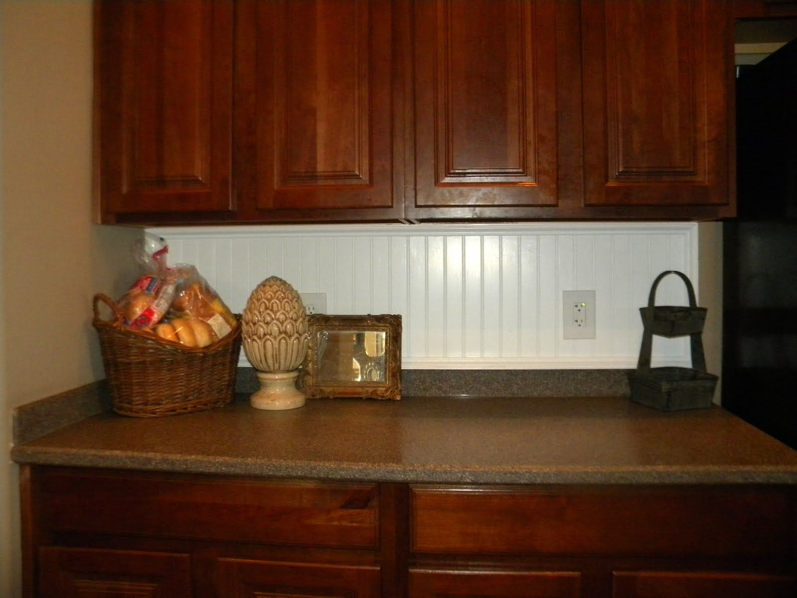 popular brown mahogany cabinets feat beadboard backsplash in white