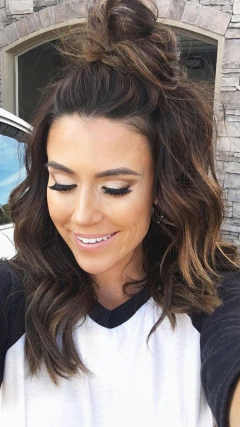 topknot, warm brunette hair, messy curls, messy waves, messy topknot