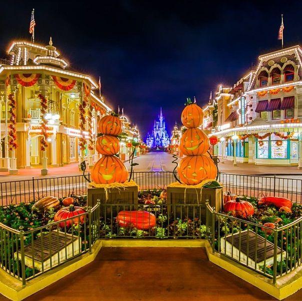 Looking down Main Street decorated for Halloween.   Walt Disney ...