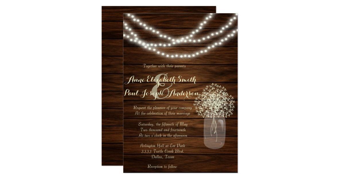Perfect for any rustic or country wedding, these invitations feature string lights with a mason jar with hydragea flowers over a light wood background.