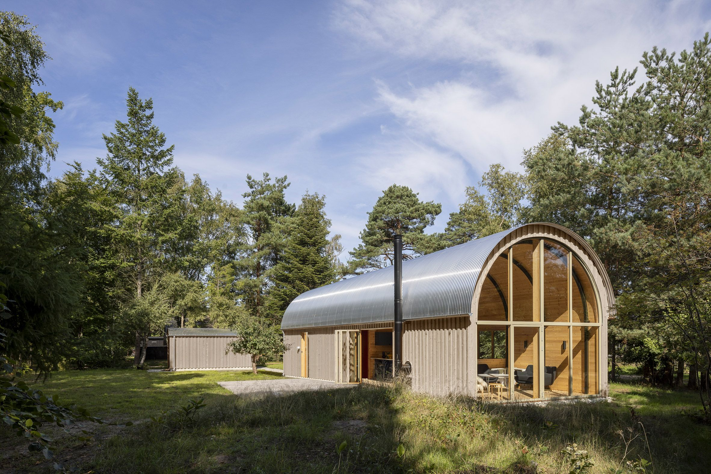 A Barrel Vault Topped With Corrugated Steel Forms The Dramatic Pine Living Space Within This Summer Cabin Near Th Corrugated Metal Roof Metal Roof Summer House