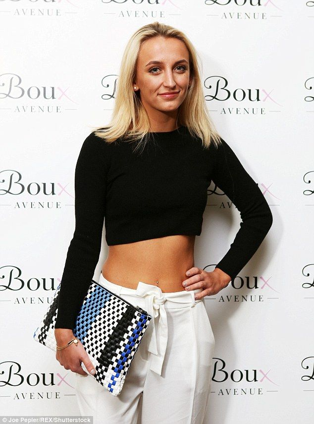 Slim jim: She teamed the long-sleeved top with white cropped trousers and black heels whil...
