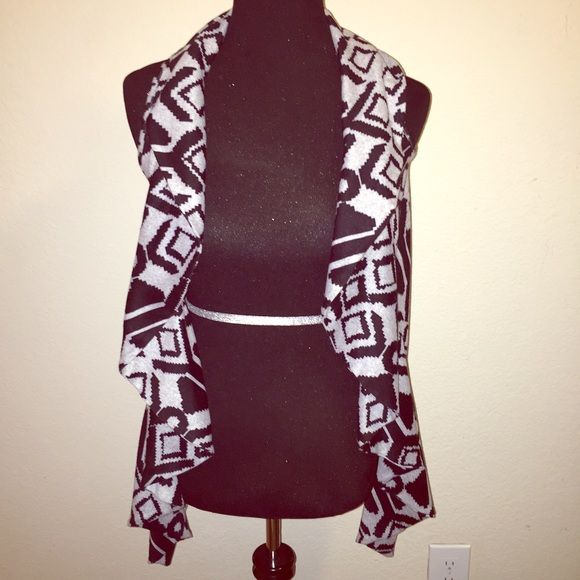 Aztec/ Tribal print vest Super cute grey and black aztec / tribal print vest. Longer in front. Purchased from another Posher. Great condition. Size Small. Material Girl Tops