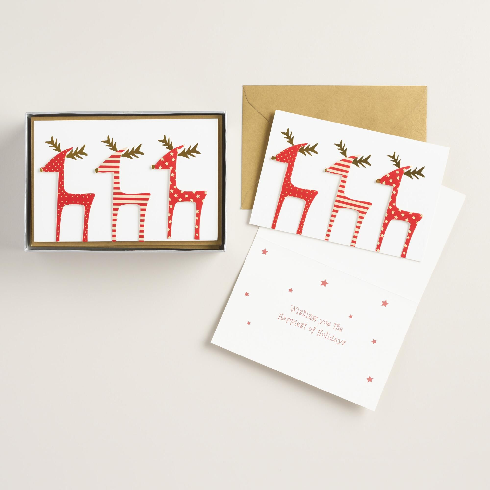 A merry way to wish friends and family a happy holiday, these cards are each decorated with three jolly red reindeer accented with gold foil.