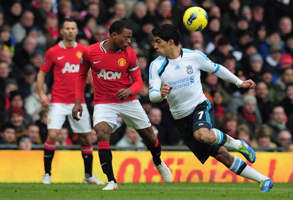 Patrice Evra Of Manchester United Heads The Ball Away From Luis Suarez Of Liverpool During The Barclays Premi Luis Suarez Liverpool Premier League Soccer News