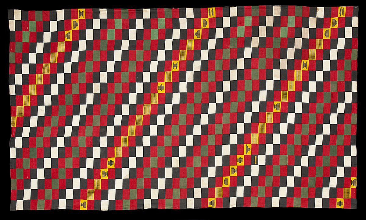 "E813 - Very rare variant of the weft faced ""checkerboard"" patterned style of Ewe man's cloth. We find very few complete examples of this weft faced style (not to be confused with the later but superficially similar blankets from Mali) and examples such as this where the weaver has added supplementary weft float motifs onto some of the blocks are particularly unusual. http://www.adireafricantextiles.com/new32.htm"