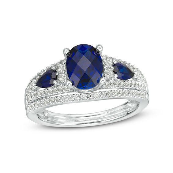 Oval Lab Created Blue Sapphire And 1 2 Ct T W Diamond Three Stone Ring In 10k White Gold White Gold Three Stone Rings Stone Rings