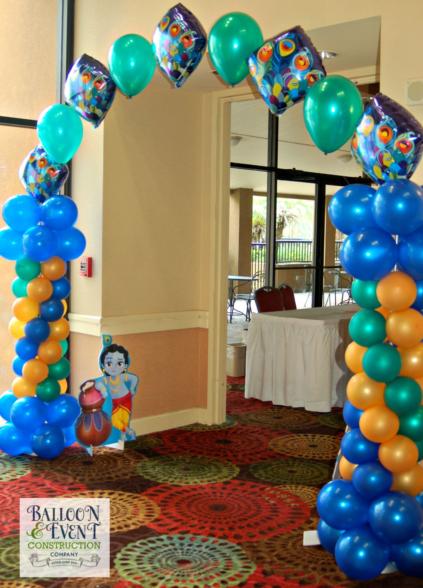 Peacock balloon arch krishna first birthday pinterest for Balloon decoration for 1st birthday party