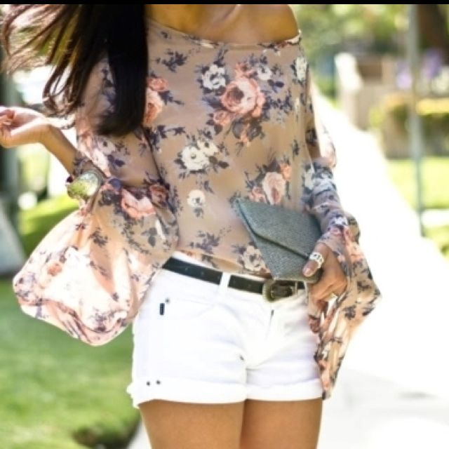 love everything about this! Sheer floral shirt, white jean shorts. Silver clutch...