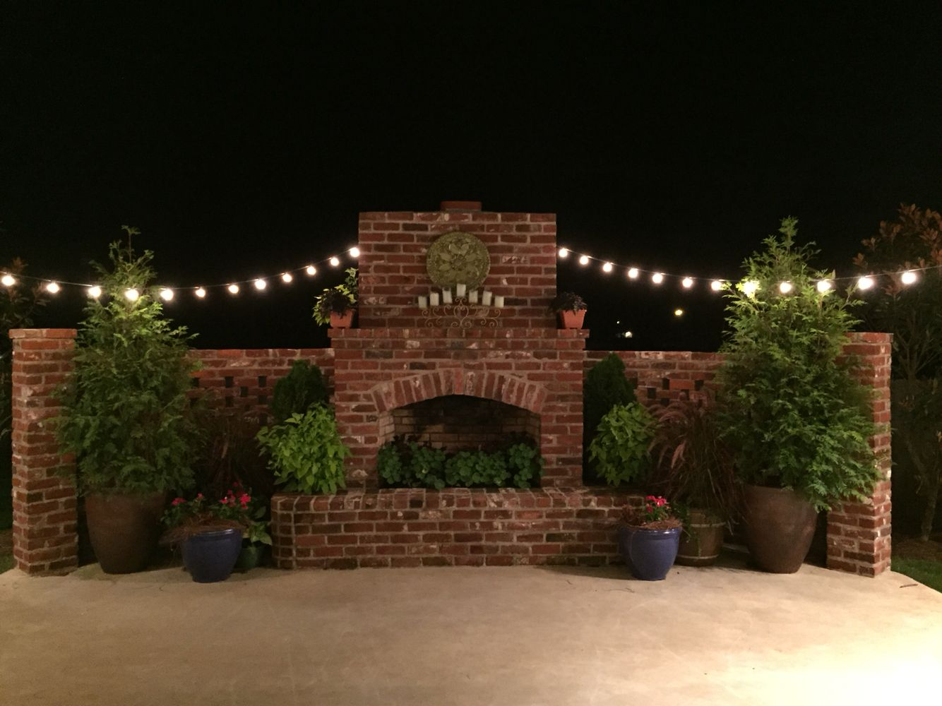 Southern courtyard with outdoor fireplace old indiana brick brick southern courtyard with outdoor fireplace old indiana brick brick latticework patio lights aloadofball Image collections