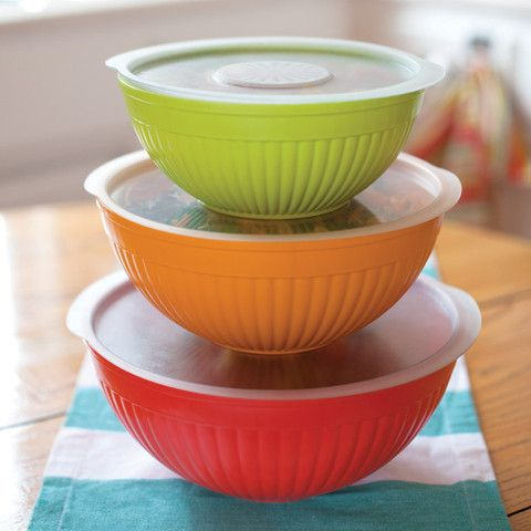 This multi-purpose 6 piece set by Nordic Ware includes 2, 3.5, and 5-quart heavy duty bowls with lids. Silicone non-skid bases. Perfect for mixing, microwaving and serving. Bowls nest for easy storage.