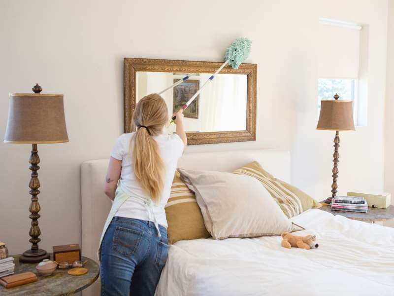 Woman Cleaning Bedroom Heshphoto Image Source Getty Images