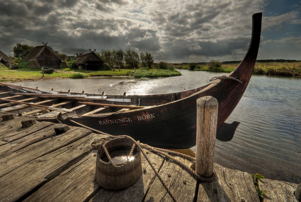 """  """"Ravnunge""""   Ravnunge, a replica of a smaller Viking boat found near Roskilde (Skuldelev 6), at the Viking harbour in Bork in western Jutland. Took this during rowing trials."""