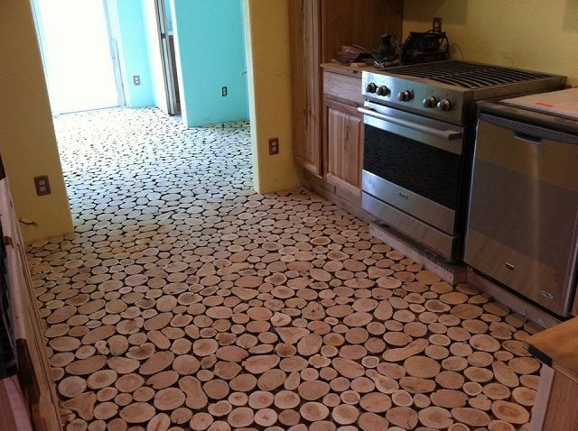 Cordwood Flooring by Sunny Pettis Murales, paredes, pisos
