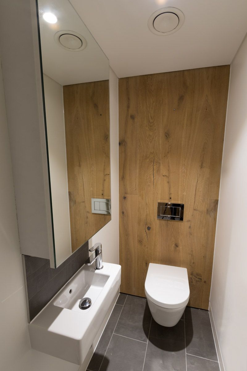 WC toilet facilities at an office in London. Modern, industrial ...