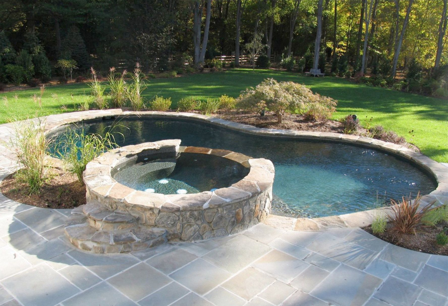 Can T Decide Between A Pool And A Hot Tub Well You Don T Have To You Can Get A Pool And Hot Tub Co Hot Tub Backyard Bluestone Patio Backyard Pool Landscaping