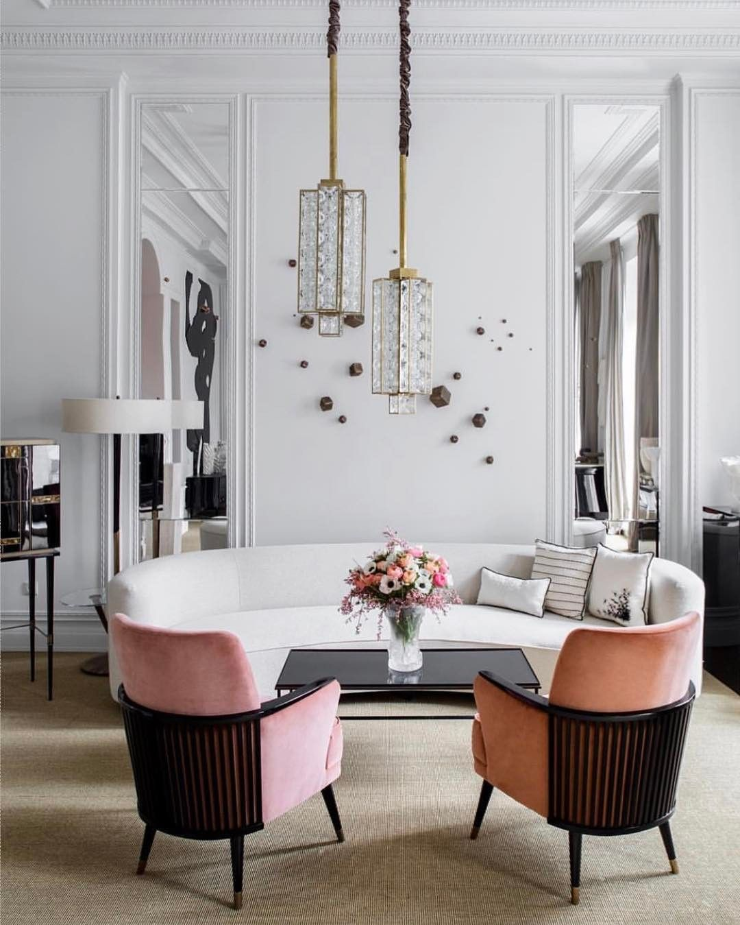 White Living Space With Blush Pink Chairs And Brass Accents