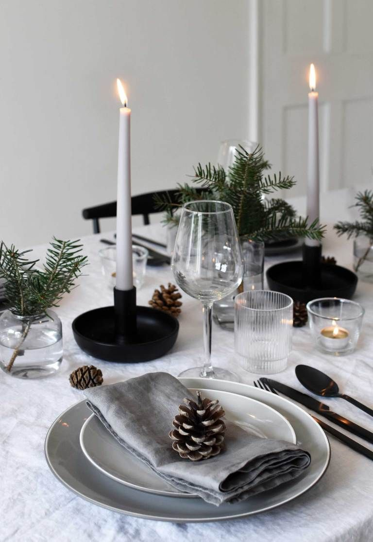 Minimalist Christmas table styling with fir, candles & pine cones | These Four Walls
