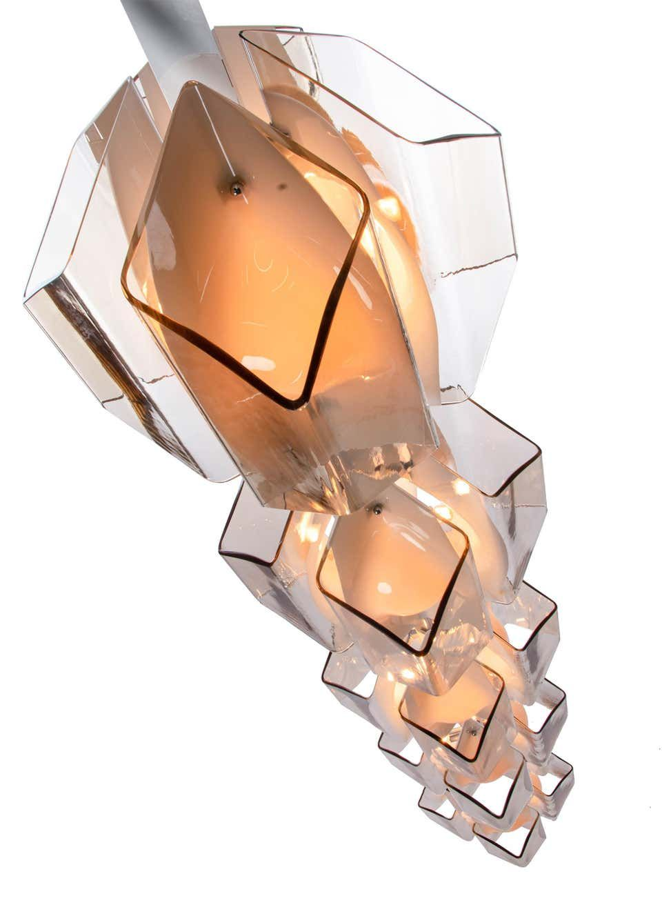 For Sale on 1stdibs - This spectacular 181 inches statement light is the perfect center piece for a lobby, foyer or entrance. It is made of large smoked and white blown Murano