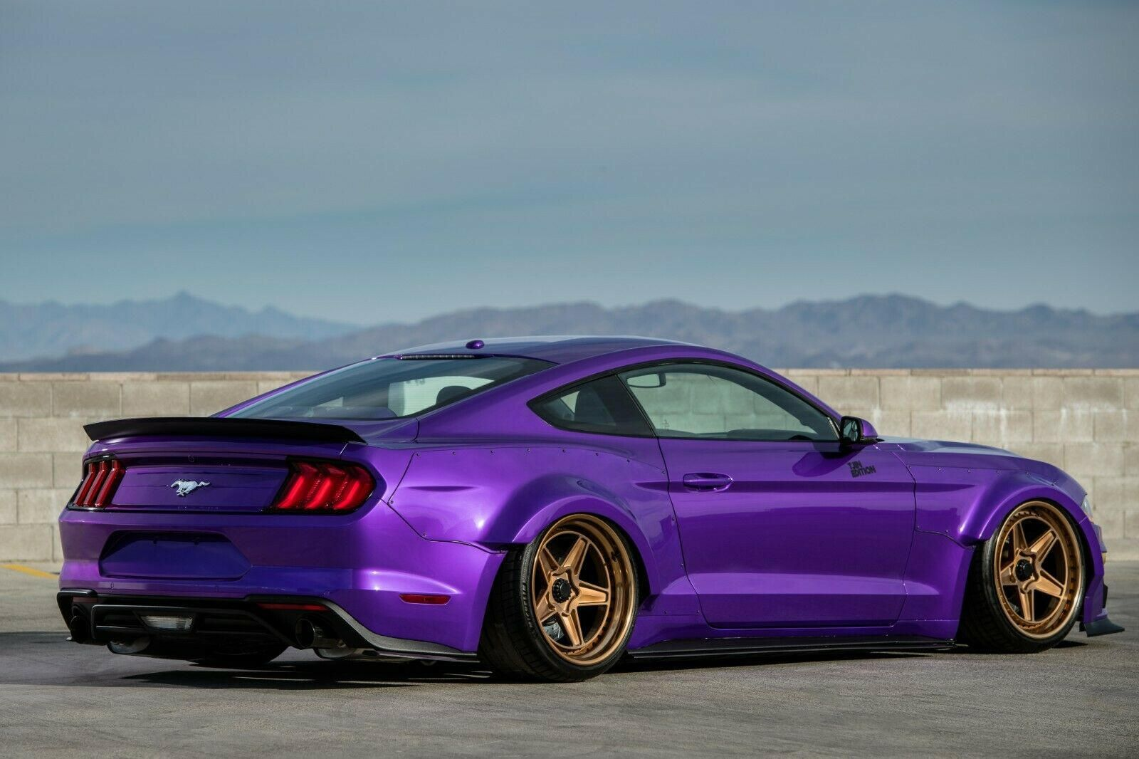 This Lamborghini Purple Ford Mustang Is Is Low Wide And Up For Grabs It Just Looks So Royal Ford Mustang Ecoboost Mustang Ecoboost Mustang