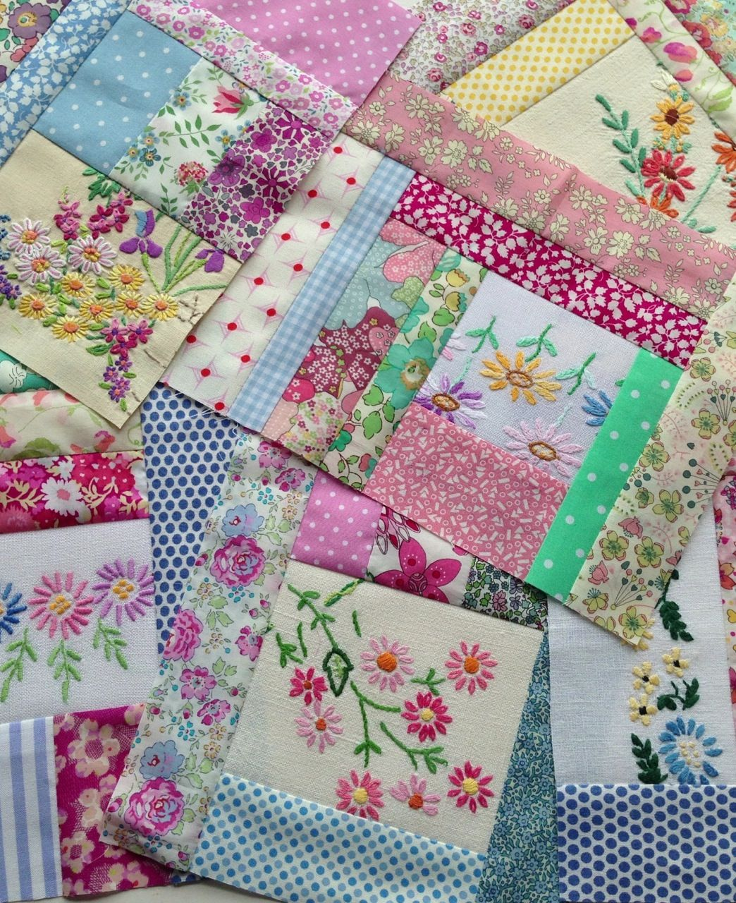 Quilt blocks built around embroidery cut from dresser