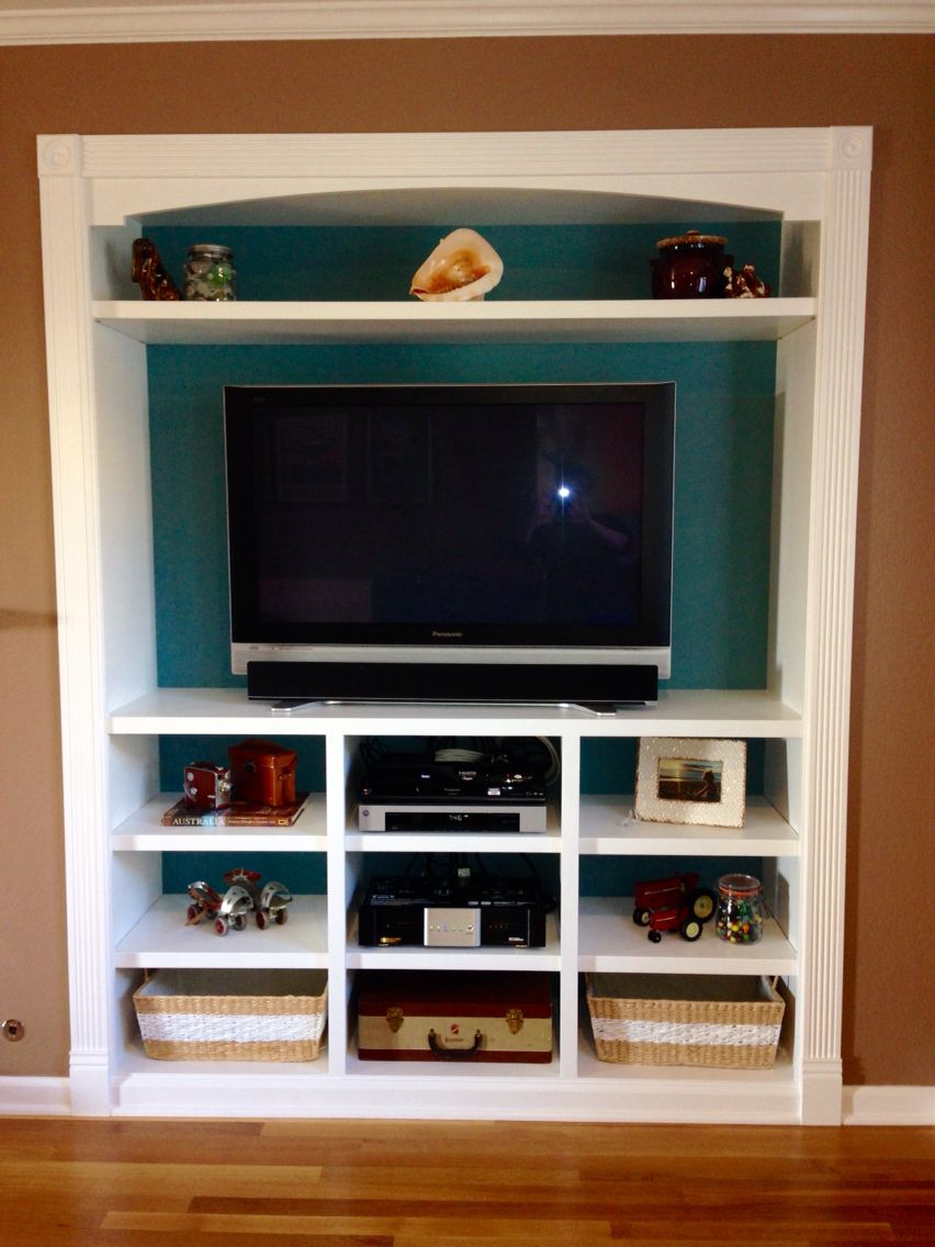 Closet Space Turned Into A Built In Entertainment Center.