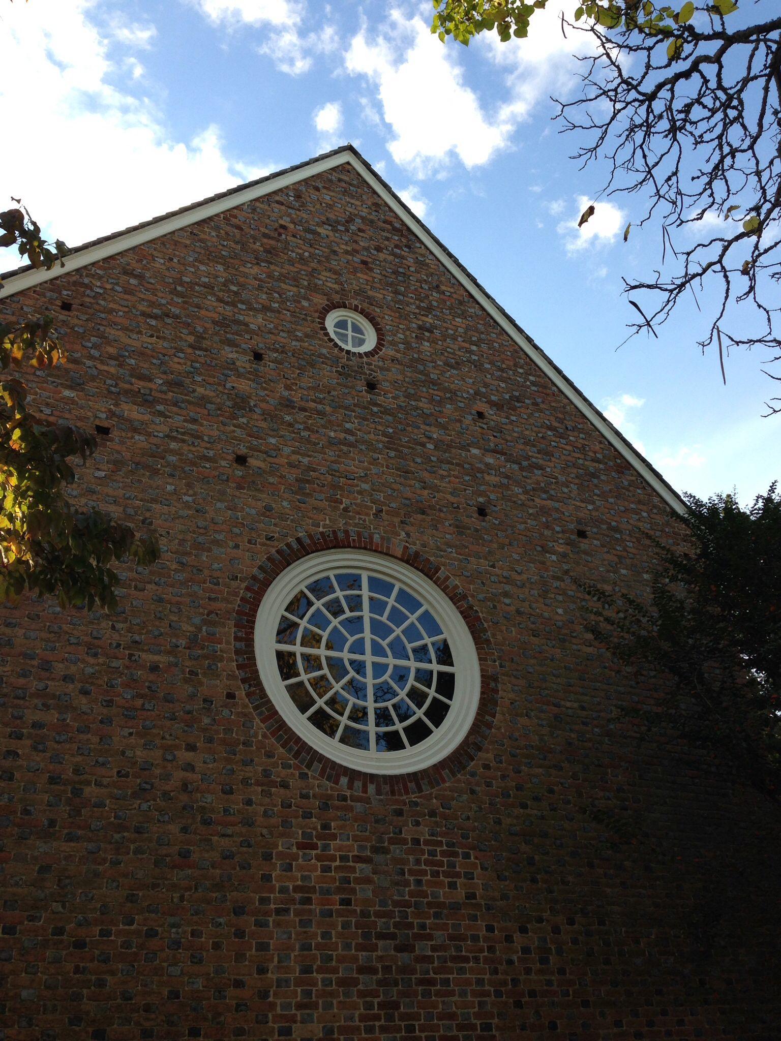 Round window on side of Bruton Parish Church in Colonial Williamsburg, Virginia © Elizabeth Higgins