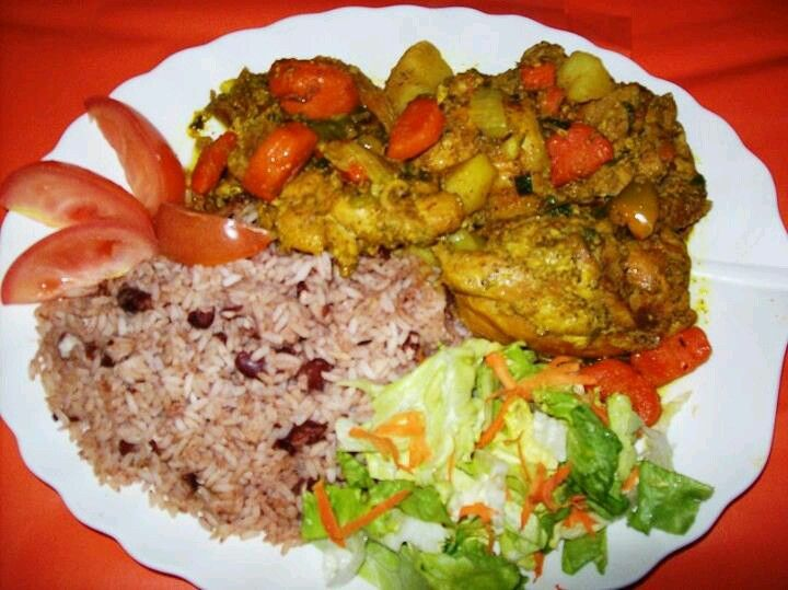 A Beautiful Plate Of Jamaican Curry Chicken Rice Peas Salad