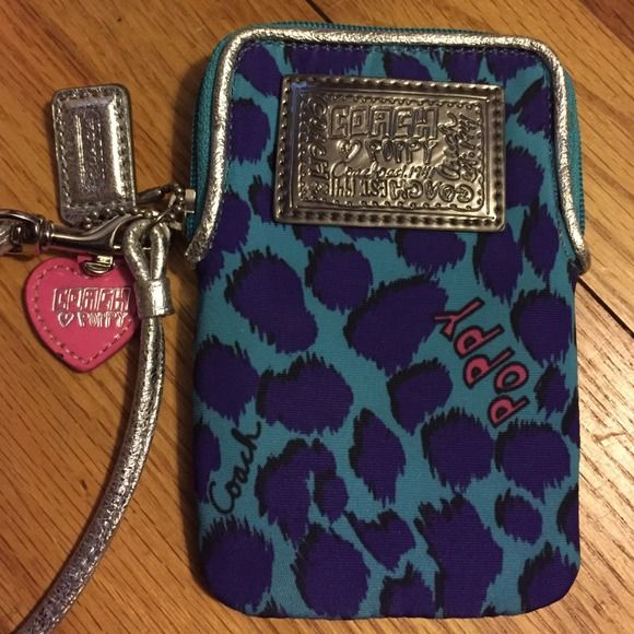 Coach Poppy Leopard Tech Case//NWT This phone case is is brand new with zero scratches, scuffs, or marks and has been kept in a smoke-free household. Case has a wrist strap and detachable keychain. Inside you'll find a large center compartment with a 1-pocket compartment on one side and a 3-pocket compartment on the other side that would be perfect for credit cards or tickets. Back of the case has another pocket.  Price is firm. Coach Bags