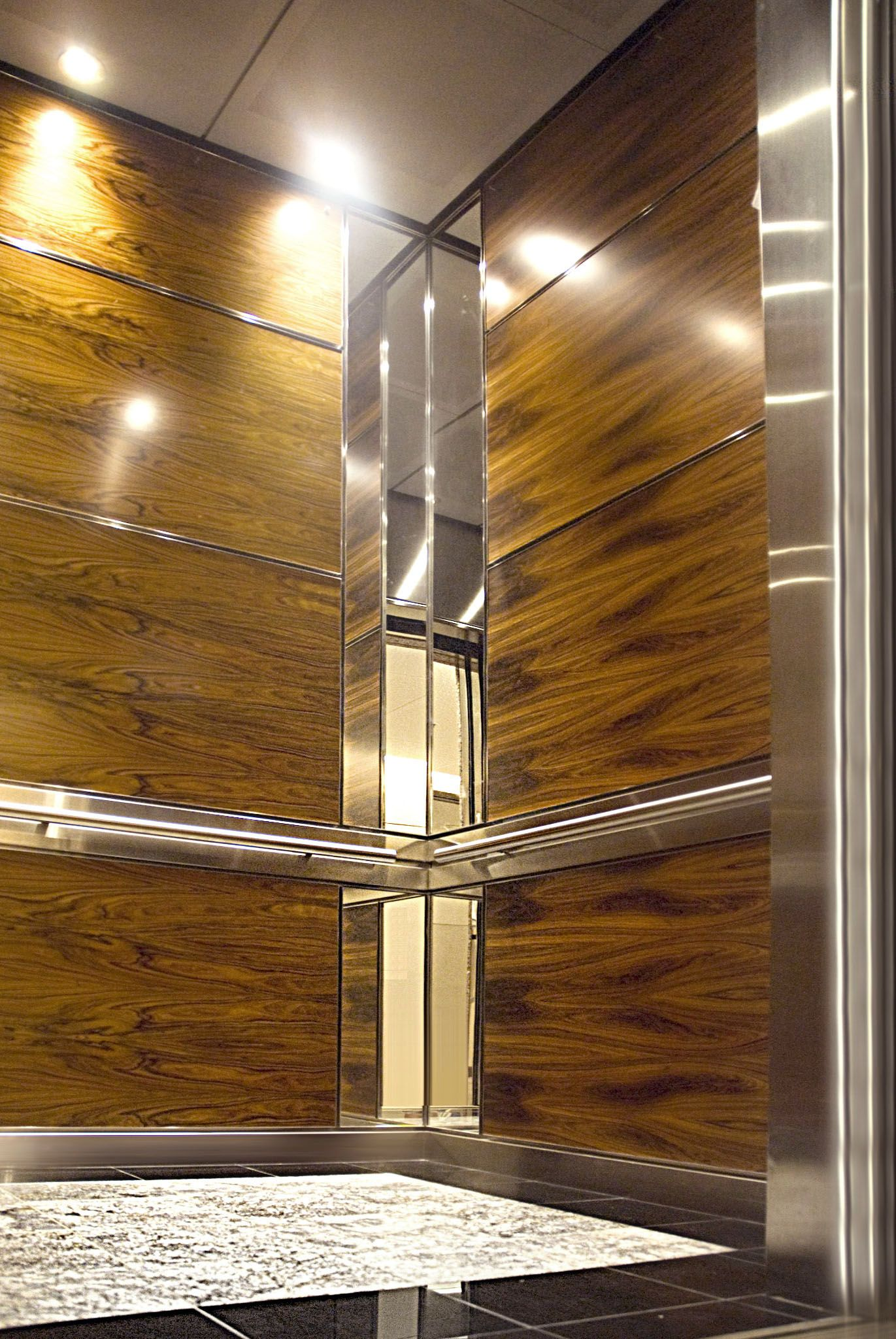 This Elevator Interior Utilized Both Durable And Natural